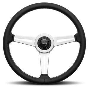 Genuine Momo Retro 360mm steering wheel. Black leather with white stitching.