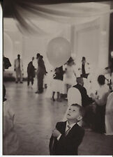 POST CARD OF A BLACK AND WHITE PICTURE OF A LITTLE BOY AT A PARTY WITH A BALLOON