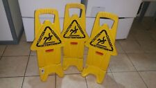 3 rubbermaid multilingual caution signs