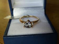 9k Gold Bi Colour Tanzanite and White Zircon Ring