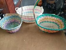 three colorful easter baskets