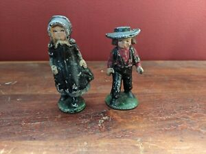 Vintage metal Amish boy and girl figurines