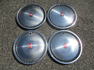 Factory original 1980 to 1984 Oldsmobile Delta 88 15 inch hubcaps wheel covers