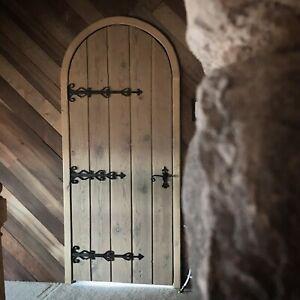 Rustic reclaimed lumber arch door solid plank wood wine cellar castle iron