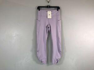 Women's Fabletics Oasis High Waisted 7/8 Length Twist Legging, Size S- Purple