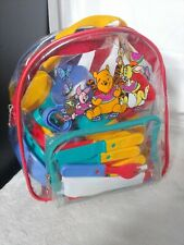 Winnie The Pooh Small Backpack w/ 30 piece plastic picnic set.