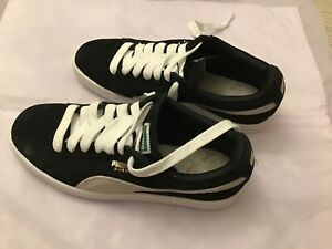 Puma suede women's sneakers size 8 US black/white