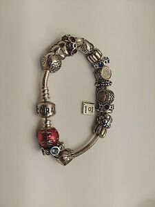 PANDORA/CHAMILIA STERLING SILVER 925 BRACELET WITH 18 CHARMS. NOT SCRAP