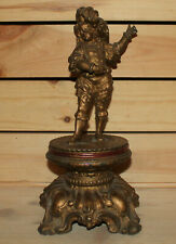 Antique hand made ornate metal man statuette