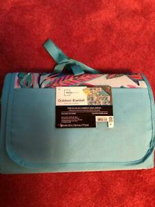OUTDOOR BLANKET 60IN X 70IN FOLD TO USE AS A  STADIUM SEAT CUSHION, NEW.
