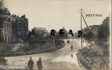 WW1 German soldiers & shell damaged buildings Peronne Grande Place in distance
