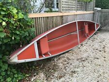 Red canoe for sale in good condition. Sold with paddles.