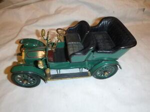 A Franklin Mint scale model of a 1905 Rolls Royce 10HP, Little Sue.  No box
