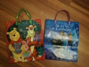 2 CHILDRENS THICK PLASTIC GIFT BAGS - WINNIE THE POOH AND FROZEN