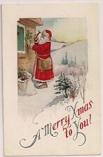 Santa Claus Hangs Holly on a house to protect the home Christmas Postcard