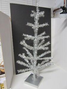 "SILVER TINSEL CHRISTMAS TREE ON WOOD BASE TABLETOP 30"" TALL"