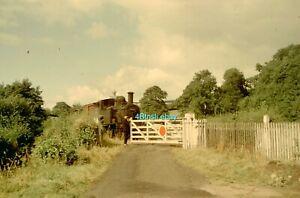 Original 35mm slide Class 14xx 0-4-2T 1420 passes through Bullocks Mill Crossing