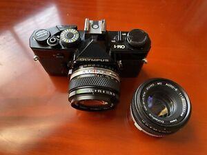 OLYMPUS OM-1 Black SLR Camera w/F.Zuiko Auto-S 50mm F1.8 and Zuiko 28mm F2.8