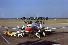 1979 FRONTIER AIRLINES CONVAIR 580 TURBO PROP GETTING FUEL BY AIRPORT CREW PHOTO