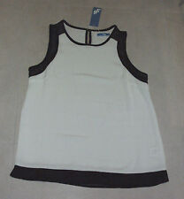 ValleyGirl: Size: 10-12. Modern White with Black Trim, Sleeveless, Design Top.