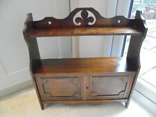 Vintage mahogany wall cupboard and shelves, carved double doors, fleur de lys
