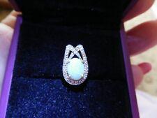 BEAUTIFUL GOLD HORSESHOE SHAPE OPAL AND DIAMOND PENDANT.