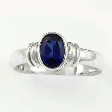 Oval cut Iolite set in a rubbed over setting Ring in S.Silver