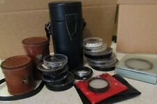 13 misc lens filters Nikon, Hoya, Tiffen, Tamron and 3 lens cases - 16 pieces