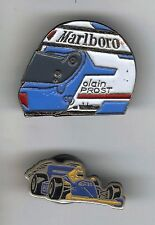 2 PINS PIN'S CASQUE ALAIN PROST MALBORO + VOITURE F1 ELF PORT A PRIX COUTANT