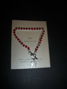 AVON ESMEE MEANING BRACELET RED WITH SUN CHARM REVIVAL AND LIGHT