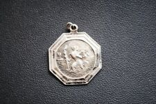 An ancient silver amulet (Elder with a child) is the protection of a traveler.