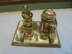 ANTIQUE BRASS DESK INKWELL ON A STAND WITH PEN REST