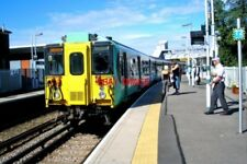 PHOTO  2010 SMITHAM RAILWAY STATION THE 10.09 UP DEPARTURE FROM SMITHAM TO LONDO