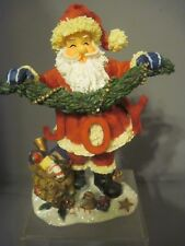 Trippies Resin Bobble Head Santa Holding Garland With Joy Attached