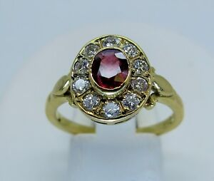 18ct yellow gold oval ruby and diamond cluster ring size O 750