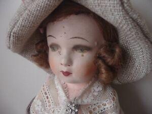Ancienne poupée tête composition tissu paille