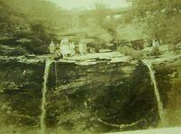 1920s Vintage Sepia Photo Sightseeing Group Standing On Waterfall Wooden Bridge