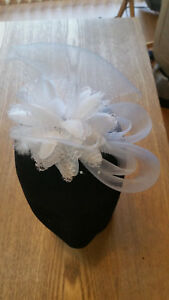 Fascinator - White  sinamay, flower, beads & feathers mounted on a clip