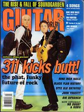 Guitar World Magazine (July 1997) 311 Kicks Butt!