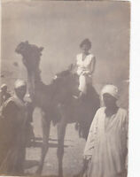 1960s Pretty woman tourist in Egypt on Camel Arab men types Soviet Russian photo