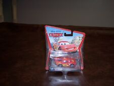 DISNEY - PIXAR- CARS 2 - LIGHTNING MC QUEEN- WITH RACING WHEELS - BAD CARD - NEW