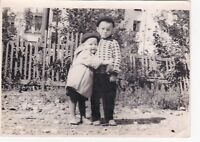 1960s Cute little boys brothers hug old fashion Soviet Russian photo