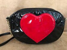 Betseyville black faux patent leather johnson heart cross body bag purse