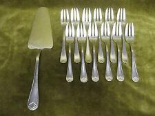 pelle à tarte,12 fourchettes à gateaux metal argente coquilles (pastry set) SD