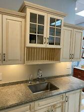 Custom Bar cabinets granite countertop, sink and faucet.