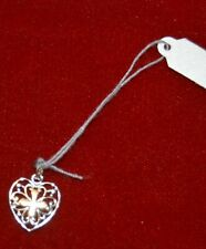 Silver heart charm with cross .925