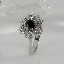 Schöner Ring in 750 Weißgold 18 K mit 1 Saphir und 6 kleinen Diamanten Gr. 56