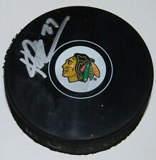 KIRBY DACH signed (CHICAGO BLACKHAWKS) Rookie autographed hockey puck W/COA