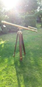 Brass telescope and wooden tripod.