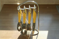 Vintage Mid-Century 24-Piece Stainless Cutlery Set on a Stand.